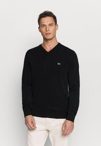 Stickad tröja - black