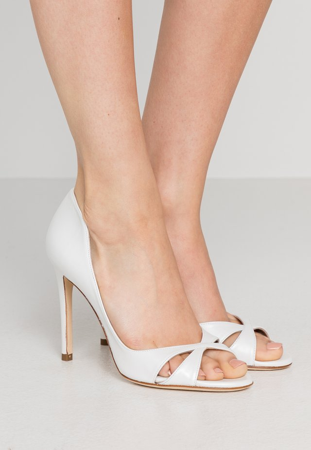 Peeptoe heels - bone