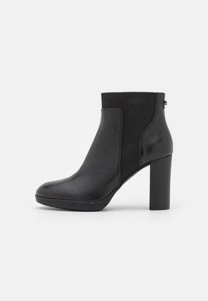 ANNYA PLATEAU - Platform ankle boots - black