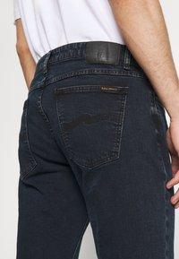 Nudie Jeans - UNISEX - Jeans slim fit - black ocean - 4