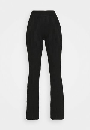 KNITTED MARL FLARES - Trousers - black