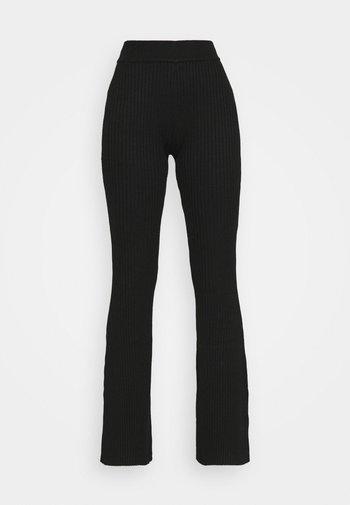 KNITTED MARL FLARES - Kalhoty - black