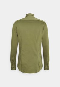 Tommy Hilfiger Tailored - SOLID SLIM SHIRT - Formal shirt - putting green - 1