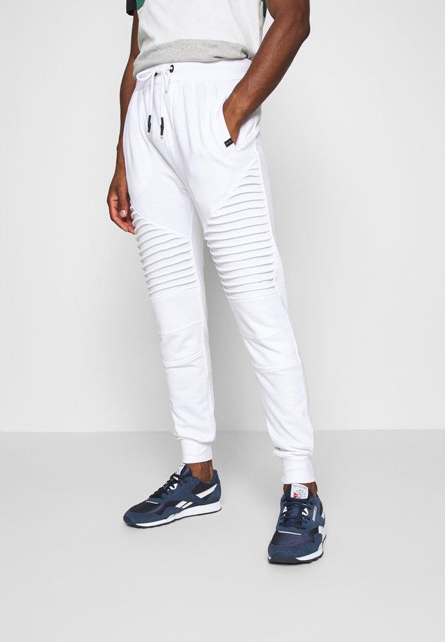 CRISTOBAL - Pantalones deportivos - white