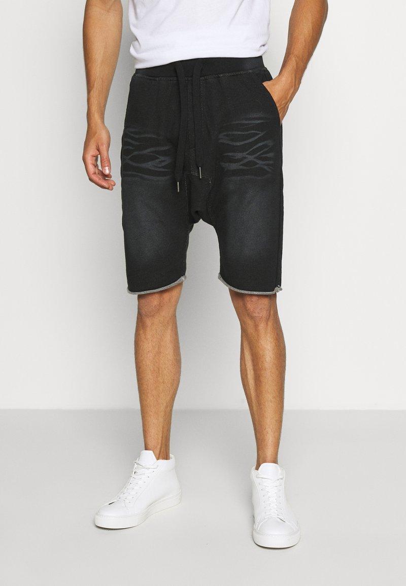 Schott - Tracksuit bottoms - black