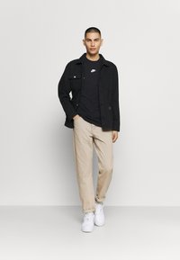Nike Sportswear - REPEAT - Print T-shirt - black - 1