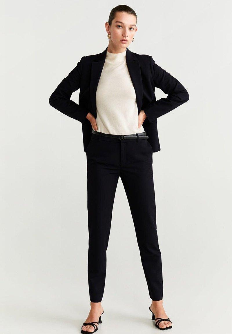 Mango - BOREAL - Trousers - schwarz