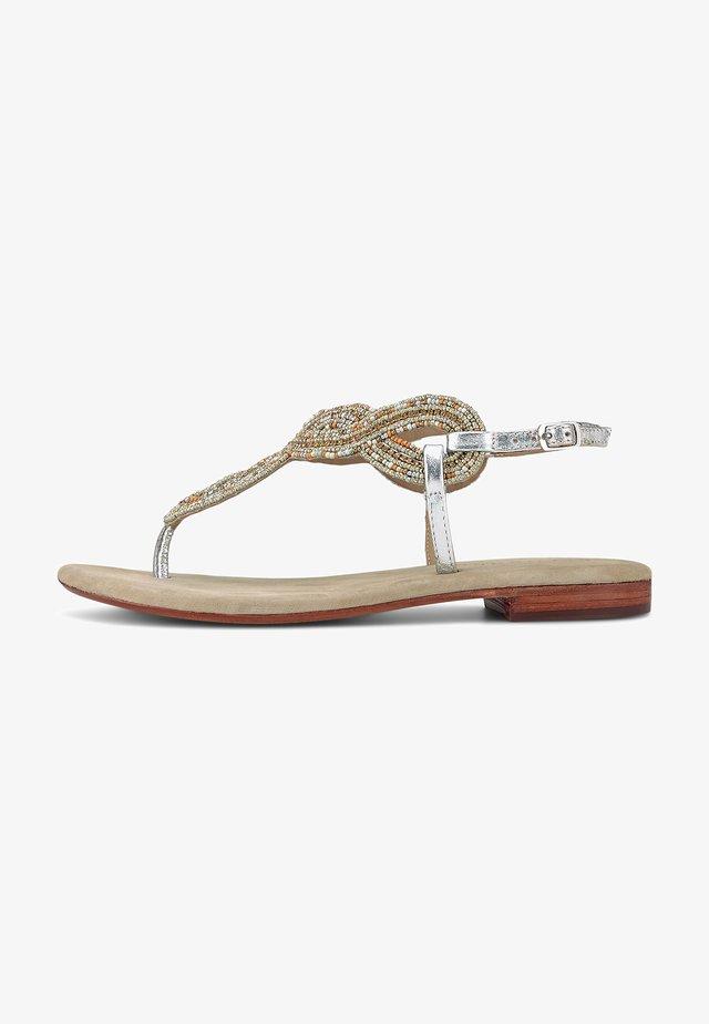 ZEHENTRENNER - T-bar sandals - silver-coloured