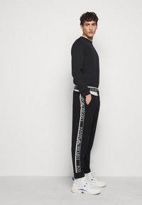 Emporio Armani - Pantaloni sportivi - black - 4