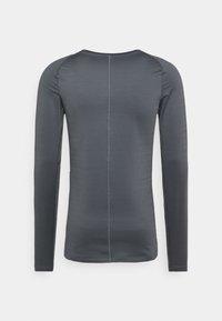 Nike Performance - WARM CREW - Sports shirt - iron grey/black - 1