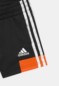 adidas Performance - UNISEX - Sportovní kraťasy - black/orange - 2