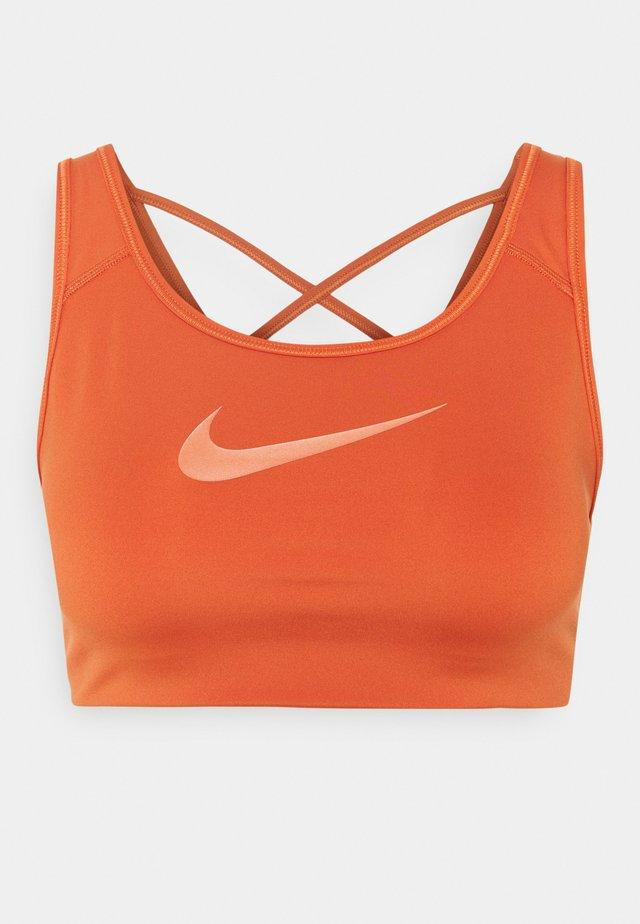 BRA - Medium support sports bra - light sienna/healing orange
