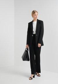 Filippa K - HUTTON TROUSERS - Trousers - black - 1