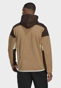 adidas Performance - Zip-up sweatshirt - brown - 1