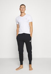 Diesel - UMLB-PETER TROUSERS - Pyjama bottoms - black - 1
