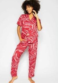 Cyberjammies - KRISTEN  - Pyjama bottoms - red spiral - 1