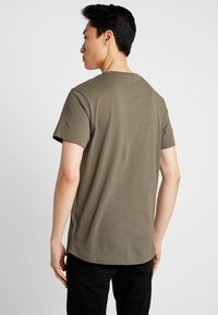 Timberland - TREE LOGO TEE - T-Shirt print - grape leaf - 2