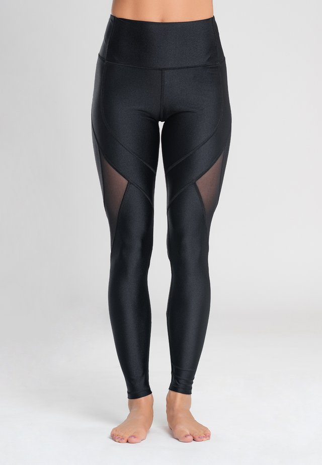INSTINCT - Leggings - black