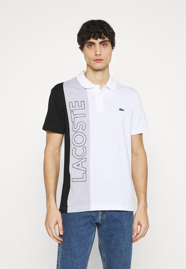 Polo - blanc/argent/chine noir