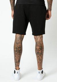 Religion - Shorts - black - 2