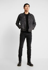 Replay - ANBASS HYPERFLEX CLOUDS - Slim fit jeans - black - 1