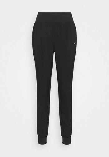 RUN FAVORITE TAPERED PANT - Pantalones deportivos - black