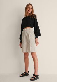 NA-KD - OPEN BACK PLEATED BLOUSE - Long sleeved top - black - 1