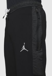 Jordan - AIR PANT - Tracksuit bottoms - black/white - 5