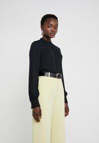 Filippa K - SHEER BUTTON BLOUSE - Button-down blouse - black - 0
