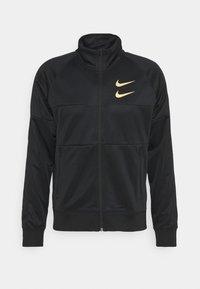 Nike Sportswear - Training jacket - black/gold foil - 4