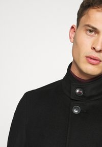 Tommy Hilfiger Tailored - SOLID STAND UP COLLAR COAT - Manteau classique - black - 5