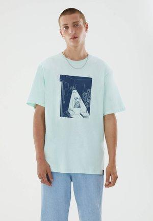 T-shirt med print - mottled light blue