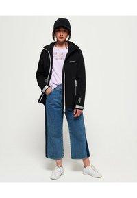 Superdry - HARPA - Waterproof jacket - black - 1