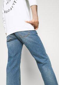 Nudie Jeans - TUFF TONY - Relaxed fit -farkut - indigo travel - 3