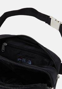 Fila - WAIST BAG MONKI - Bum bag - black - 2