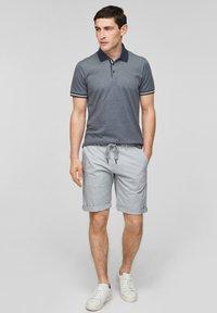 s.Oliver BLACK LABEL - MET GESTREEPTE BOORDJES - Polo shirt - dark blue melange - 1
