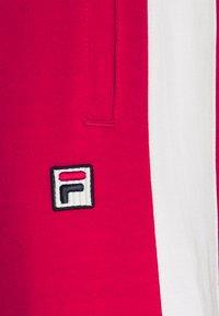 Fila - SETTANTA TRACK PANTS - Tracksuit bottoms - true red/blanc de blanc - 2