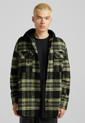 OVERSIZE MIT KAPUZE - Short coat - black
