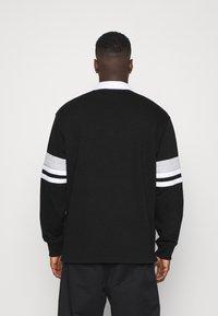 Weekday - OMAR HALFZIP - Polo shirt - black - 2