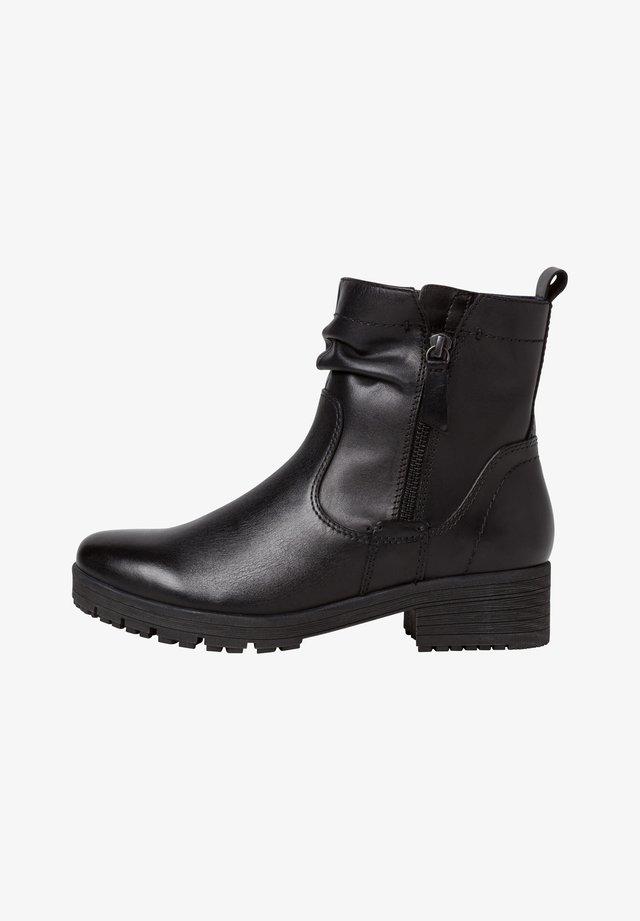 STIEFELETTE - Kotníková obuv - black uni
