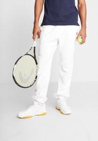 Nike Performance - PANT HERITAGE - Tracksuit bottoms - white - 0