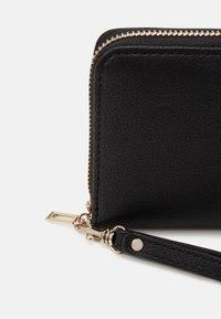 Guess - NOELLE LARGE ZIP AROUND - Wallet - black - 3