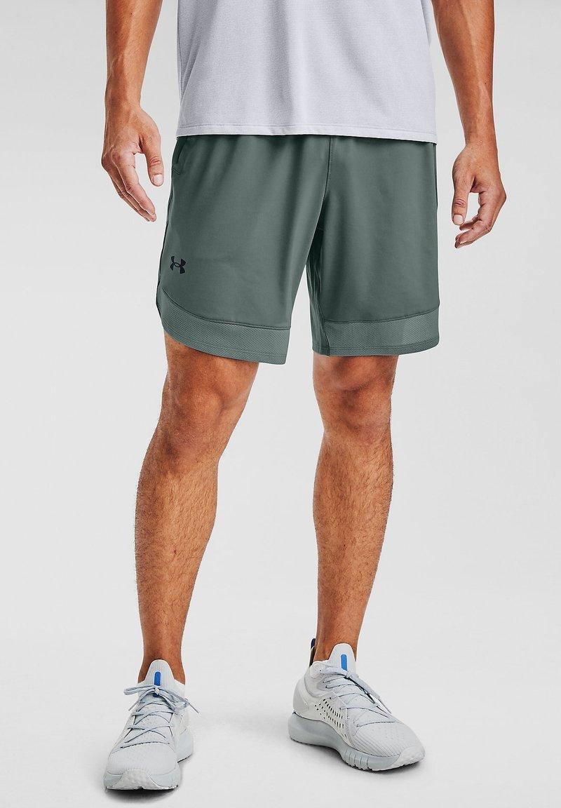 Under Armour - TRAIN STRETCH - Sports shorts - lichen blue