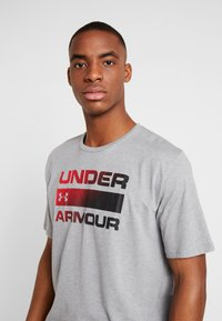 Under Armour - HEATGEAR - T-shirt print - steel light heather/black - 3