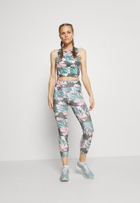 Nike Performance - FAST CROP RUNWAY - Leggings - pink - 1