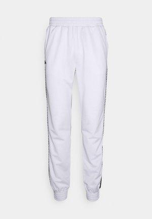 INGVALDO - Tracksuit bottoms - bright white