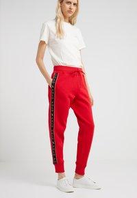 Polo Ralph Lauren - SEASONAL - Tracksuit bottoms - red - 0