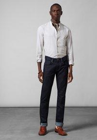 Baldessarini - JOHN - Slim fit jeans - dark blue rinsed - 0