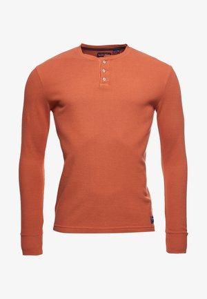 Long sleeved top - smoked orange
