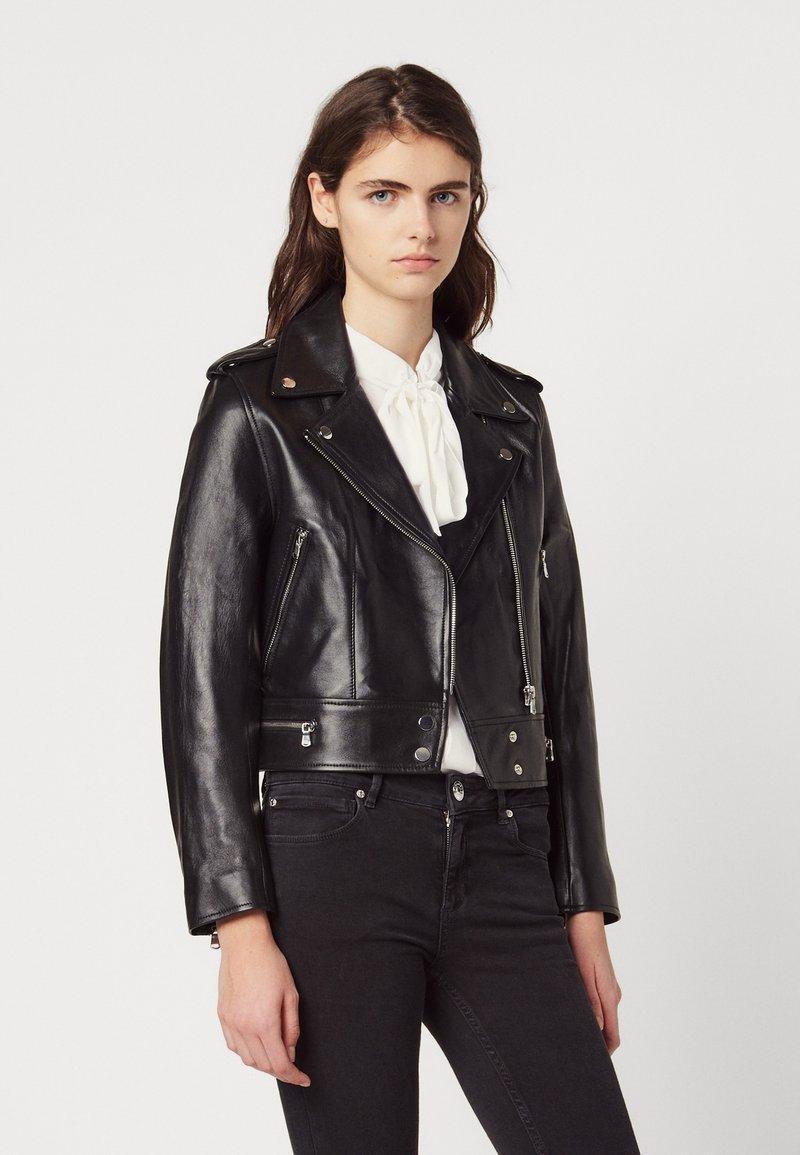 sandro - SIOUXIE - Leather jacket - noir